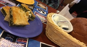 Gratis appetizers...the best spinach pie and freshly baked loaf of Greek bread.