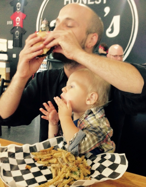 Teaching a son how to love a good burger!